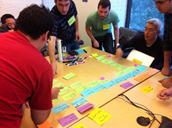 People collaborating at Pathfinder workshop