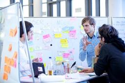 People discussing design ideas at Pathfinder workshop