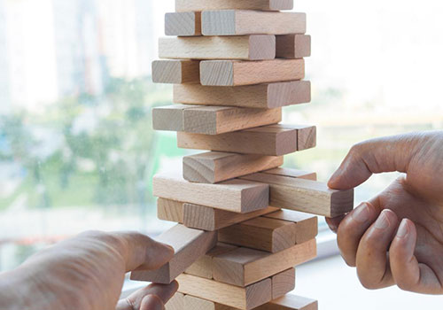 Why is removing the current blocker a best practice for Agile and DevOps?